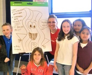 Kendra Spanjer at a school assembly